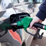 Close up of car refuel in gas station, petrol oil concept, copyspace for text